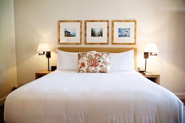 three burlwood frames above hotel bed