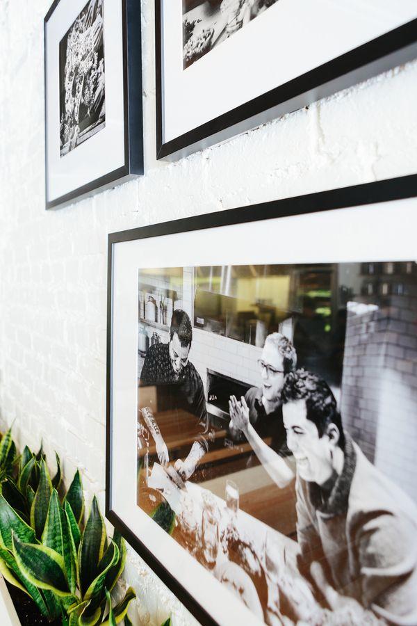 gallery wall at cava restaurant